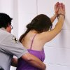 A woman arrested in morning drug raid stands handcuffed against the wall while she is frisked by an Oklahoma County Sheriff\'s deputy in a processing room Tuesday, June 29, 2010, Photo by Jim Beckel, The Oklahoman