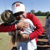 Hilldale head coach Darren Riddle hugs infielder Sarah Hughey as they defeat Bethel 7-0 in the State 4A Softball Championship game on Saturday, Oct. 19, 2013 in Shawnee, Okla. Photo by Steve Sisney, The Oklahoman