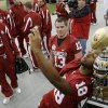 OU\'s Cortney Carter, right, takes his photo with the Fiesta Bowl trophy as Mike Knall, center, and Quinton Carter watch during media day at the University of Phoenix Stadium in Glendale, Ariz., on Monday, Dec. 31, 2007. The University of Oklahoma (OU) college football team will play West Virginia University in the Fiesta Bowl on Jan. 2, 2008. BY BRYAN TERRY, THE OKLAHOMAN ORG XMIT: KOD