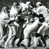 The Oklahoma defense puts the skids on a rushing attempt by OSU fullback Will Timmons during the Bedlam college football game on Nov. 30, 1985. Staff Photo by Paul Hellstern
