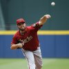 Photo - Arizona Diamondbacks starting pitcher Wade Miley throws in the first inning of a baseball game against the Atlanta Braves, Sunday, July 6, 2014, in Atlanta. (AP Photo/David Goldman)