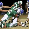 Antlers runningback Brennan Miyake is pushed back by several McGuinness tacklers including Bobby Sweeney, #8. Deer Creek Antlers vs. Bishop McGuinness Fighting Irish at Pribil Stadium Friday night, Nov. 2, 2012. Photo by Jim Beckel, The Oklahoman