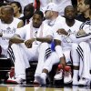 From left, Miami Heat\'s Ray Allen, Mario Chalmers, Dwyane Wade and Shane Battier sit on the bench in the second half of Game 2 of their NBA basketball playoff series in the Eastern Conference semifinals against the Chicago Bulls, Wednesday, May 8, 2013, in Miami. The Heat won 115-78. (AP Photo/Lynne Sladky)