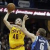 Cleveland Cavaliers\' Tyler Zeller (40) shoots over Dallas Mavericks\' Troy Murphy (6) in the second quarter of an NBA basketball game on Saturday, Nov. 17, 2012, in Cleveland. (AP Photo/Mark Duncan)