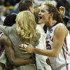 NCAA TOURNAMENT / WOMEN\'S COLLEGE BASKETBALL: Head coach Sherri Coale hugs Danielle Robinson as Whitney Hand smiles as the University of Oklahoma (OU) defeats Georgia Tech 69-50 in round two of the 2009 NCAA Division I Women\'s Basketball Tournament at Carver-Hawkeye Arena at the University of Iowa in Iowa City, IA on Tuesday, March 24, 2009. PHOTO BY STEVE SISNEY, THE OKLAHOMAN ORG XMIT: KOD