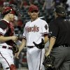 Photo -   Arizona Diamondbacks' Ian Kennedy, middle, and Miguel Montero, left, talks with umpire Doug Eddings after the San Diego Padres scored a run in the first inning of a baseball game Tuesday, Sept. 18, 2012, in Phoenix. (AP Photo/Ross D. Franklin)
