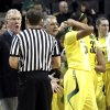 Photo - Oregon coach Paul Westhead, left, argues with a referee during a time out in the second half of an NCAA college basketball game against Stanford in Eugene, Ore., Friday, Feb. 1, 2013. Stanford won 86-62. (AP Photo/Don Ryan)