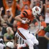 Photo - Oregon State quarterback Sean Mannion (4) scores a touchdown against Portland State during the second quarter of an NCAA college football game in Corvallis, Ore., Saturday, Aug. 30, 2014. (AP Photo/Troy Wayrynen)