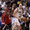 Dallas Mavericks\' Chris Kaman (35) looks for an opening to the basket against Washington Wizards\' Kevin Seraphin (13), of France, in the first half of an NBA basketball game, Wednesday, Nov. 14, 2012, in Dallas. (AP Photo/Tony Gutierrez)