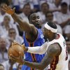 Miami Heat small forward LeBron James (6) passes around Oklahoma City Thunder center Kendrick Perkins (5) during the second half at Game 3 of the NBA Finals basketball series, Sunday, June 17, 2012, in Miami. (AP Photo/Lynne Sladky) ORG XMIT: NBA143