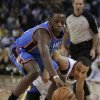 Oklahoma City Thunder\'s Reggie Jackson, left, and Golden State Warriors\' Stephen Curry chase a loose ball during the first half of an NBA basketball game Thursday, Nov. 14, 2013, in Oakland, Calif. (AP Photo/Ben Margot)