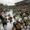 Photo -   California football players run on to the field for their NCAA college football game against Nevada at Memorial Stadium, Saturday, Sept. 1, 2012, in Berkeley, Calif. (AP Photo/Ben Margot)