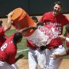 The Redhawks\' pour water on Matt Duffy, center after driving in the winning run during their game against the Salt Lake Bees at the Chickasaw Bricktown Ballpark in Oklahoma City, Wednesday June 11, 2014. Photo By Steve Gooch, The Oklahoman