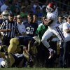 Oklahoma\'s Sterling Shepard (3) leaps to avoid a tackle by Notre Dame players during the first half of an NCAA college football game on Saturday, Sept. 28, 2013, in South Bend, Ind. (AP Photo/Darron Cummings) ORG XMIT: INDC111