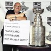 In this undated image provided by the Los Angeles Kings, veteran public address announcer David Courtney points at the Stanley Cup. Courtney, the veteran public address announcer for the Los Angeles Clippers, Kings and Angels, died Thursday Nov. 29, 2012. He was 56. (AP Photo/Los Angeles Kings)
