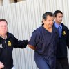 Marco Antonio Delgado is escorted out of the El Paso County Jail, Monday, Nov. 5, 2012 in El Paso, Texas. Delgado was arrested by Immigration and Customs Enforcement on charges of conspiracy to commit money laundering according to jail records. (AP Photo/Juan Carlos Llorca)