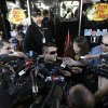 Driver Tony Stewart is swarmed by the media as he answers questions for after practice Sunday\'s NASCAR Sprint Cup auto race at Martinsville Speedway in Martinsville, Va., Friday, April 5, 2013. (AP Photo/Steve Helber)