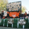 OSU fans ride a float in the Oklahoma State Cowboy\'s homecoming parade in downtown Stillwater, OK, Saturday, Oct. 29, 2011. By Paul Hellstern, The Oklahoman