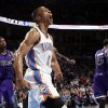 Oklahoma City\'s Russell Westbrook (0) reacts in front of Sacramento\'s Isaiah Thomas (22), Jason Thompson (34) and DeMarcus Cousins (15) after dunking the ball on a lob pass from Kevin Durant during the NBA basketball game between the Oklahoma City Thunder and the Sacramento Kings at Chesapeake Energy Arena in Oklahoma City, Friday, April 13, 2012. Photo by Nate Billings, The Oklahoman