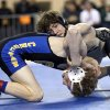Sand Springs\' Daton Fix, right, wrestles Choctaw\'s Garrett Rowe in the 6A 113-pound match during the Oklahoma State wrestling championships at the State Fair Arena, Saturday, March 1. 2014. Photo by Sarah Phipps, The Oklahoman