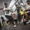 In this June 17, 2014 photo, Marc Mack, 8, a member with the dance troupe W.A.F.F.L.E., performs on a subway, in New York. Police Commissioner William Bratton\'s department