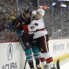 Photo - Ottawa Senators defenseman Jared Cowen, right, puts Anaheim Ducks right wing Emerson Etem into the boards during the first period of their NHL hockey game, Sunday, Oct. 13, 2013, in Anaheim, Calif. (AP Photo/Mark J. Terrill)