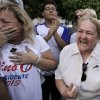 Supporters of the late Paraguayan presidential candidate Lino Cesar Oviedo react outside the morgue where his remains were taken after he died in a helicopter crash in Asuncion, Paraguay, Sunday, Feb. 3, 2013. Oviedo was returning with his bodyguard from a political rally in northern Paraguay Saturday night when his pilot encountered bad weather. All three were killed in the crash, said Johnny Villalba, a spokesman for Paraguay\'s airport authority. (AP Photo/Jorge Saenz)