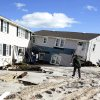 People survey damage to beachfront houses in Long Beach Island, N.J., Wednesday, Oct. 31, 2012. New Jersey received the brunt of superstorm Sandy, which made landfall in the state and killed six people. More than 2 million customers were without power as of Wednesday afternoon, down from a peak of 2.7 million. (AP Photo/Philadelphia Inquirer, Ed Hille) PHIX OUT; TV OUT; MAGS OUT; NEWARK OUT