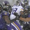 Photo - Minnesota Vikings running back Adrian Peterson (28) is tackled by Baltimore Ravens inside linebackers Jameel McClain, left, and Daryl Smith as he rushes the ball in the first half of an NFL football game, Sunday, Dec. 8, 2013, in Baltimore. (AP Photo/Nick Wass)