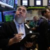 Photo - Trader Edward McCarthy, left, works on the floor of the New York Stock Exchange, Thursday, Aug. 21, 2014. U.S. stocks are opening higher, pushing the Standard & Poor's 500 index closer toward another record high. (AP Photo/Richard Drew)