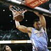 Denver Nuggets\' JaVale McGee (34) dunks as Phoenix Suns\' Luis Scola, of Argentina, watches in the first half during an NBA basketball game on Monday, Nov. 12, 2012, in Phoenix. (AP Photo/Ross D. Franklin)