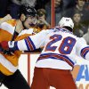 Philadelphia Flyers\' Tye McGinn, left, and New York Rangers\' Kris Newbury fight during the second period of an NHL hockey game, Thursday, Jan. 24, 2013, in Philadelphia. (AP Photo/Matt Slocum)