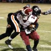 Wayne\'s Charlie Garnder (21) is called for a facemask penalty as he stops Wynnewood\'s T. J. Ellis (24) in high school Football on Friday, Oct. 26, 2012 in Wayne, Okla. Photo by Steve Sisney, The Oklahoman