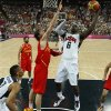 The United State\'s Lebron James,center, shoots over Spain\'s Pau Gasol during their men\'s gold medal basketball match at the North Greenwich Arena in London during the London 2012 Olympic Games, Sunday, Aug. 12, 2012.( AP Photo/ Sergio Perez, Pool)