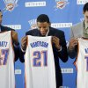 Grant Jerrett, Andre Roberson and Steven Adams hold their jerseys during a press conference at the Thunder Events center, Saturday, July 29, 2013. Photo by Sarah Phipps, The Oklahoman