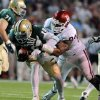 Oklahoma\'s Frank Alexander, right, sacks Baylor quarterback Robert Griffin III, left, in the first half of an NCAA college football game, Saturday, Nov. 19, 2011, in Waco, Texas. (AP Photo/Waco Tribune Herald, Rod Aydelotte)
