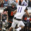 Oklahoma State\'s Daytawion Lowe (8) returns an interception past TCU\'s Skye Dawson (11) in the fourth quarter during a college football game between Oklahoma State University (OSU) and Texas Christian University (TCU) at Boone Pickens Stadium in Stillwater, Okla., Saturday, Oct. 27, 2012. OSU won, 36-14. Photo by Nate Billings, The Oklahoman
