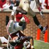 DeMarco Murray (7) is tackled by Greg Reid (5) as Christian Jones (7) leaps over them during the first half of the college football game between the University of Oklahoma Sooners (OU) and Florida State University Seminoles (FSU) at the Gaylord Family-Oklahoma Memorial Stadium on Saturday, Sept. 11 2010, in Norman, Okla. Photo by Steve Sisney, The Oklahoman