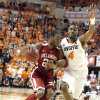 Oklahoma\'s Amath M\'Baye (22) tries to get by Oklahoma State\'s Brian Williams (4) during the Bedlam men\'s college basketball game between the Oklahoma State University Cowboys and the University of Oklahoma Sooners at Gallagher-Iba Arena in Stillwater, Okla., Saturday, Feb. 16, 2013. Photo by Sarah Phipps, The Oklahoman