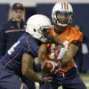 Photo - In this photo taken on Tuesday, March 18, 2014, Auburn quarterback Nick Marshall (14) hands off to running back Cameron Artis-Payne (44) during Auburn's first spring NCAA college football practice at the Auburn Athletic Complex in Auburn, Ala. (AP PHOTO/AL.com, Julie Bennett) MAGS OUT