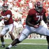Alabama quarterback AJ McCarron (10) get set to throw a touchdown pass as offensive lineman Cyrus Kouandjio (71) blocks against Georgia State during the first half of an NCAA college football game on Saturday, Oct. 5, 2013, in Tuscaloosa, Ala. (AP Photo/Butch Dill)