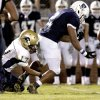 Heritage Hall's Chedon Shockley, left, tackles Casady's Cassius Calhoun as Calhoun loses control of the ball during a 2010 game at Casady. Photo by Bryan Terry, The Oklahoman Archives