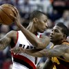 Cleveland Cavaliers forward Alonzo Gee, right, pressures Portland Trail Blazers guard Damian Lillard during the first quarter of an NBA basketball game in Portland, Ore., Wednesday, Jan. 16, 2013. (AP Photo/Don Ryan)