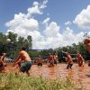 Competitors play volleyball in a pit of mud during the twelfth annual MUDD Volleyball tournament to benefit the Muscular Dystrophy Association, in Mustang, Okla., Saturday, July 20, 2013. Photo by Nate Billings, The Oklahoman