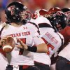 Texas Tech\'s Seth Doege (7) looks to pass the ball during the college football game between the University of Oklahoma Sooners (OU) and Texas Tech University Red Raiders (TTU) at the Gaylord Family-Oklahoma Memorial Stadium on Saturday, Oct. 22, 2011. in Norman, Okla. Photo by Chris Landsberger, The Oklahoman