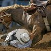 IFYR: Tyke Kipp of Lordsburg, N.M., takes cover after falling off his horse in the saddle bronc event during the International Finals Youth Rodeo in Shawnee, Okla., Friday, July 16, 2010. Photo by Bryan Terry, The Oklahoman ORG XMIT: KOD