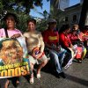 Supporters of Venezuela\'s President Hugo Chavez, one of them holding a sign that reads in Spanish