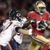 San Francisco 49ers tight end Vernon Davis (85) runs with a pass against Chicago Bears free safety Chris Conte (47) and outside linebacker Lance Briggs (55) during the first half of an NFL football game in San Francisco, Monday, Nov. 19, 2012. (AP Photo/Tony Avelar)