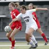 Photo - GIRLS HIGH SCHOOL SOCCER: Yukon's Sarah Wilson (18) fights for the ball with Edmond's Kenzie Burger (19) during the Bronco Cup Soccer Tournament at Mustang High School on Thursday, March 28, 2013, in Mustang, Okla.  Photo by Chris Landsberger, The Oklahoman