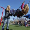 enjoy the warm weather at a playground at First Baptist Church on Wednesday, Dec. 28, 2011, in Norman, Okla. Photo by Steve Sisney, The Oklahoman